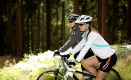 Two women cycling in the forest